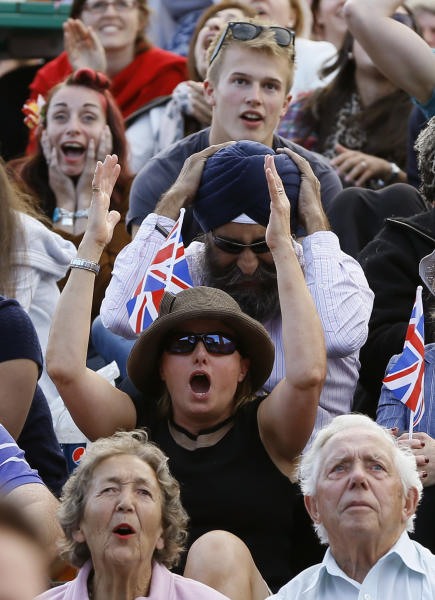 Spectators react as they watch Andy Murray of Britain face Fernando Verdasco of Spain in a Men's singles quarterfinal match at the All England Lawn Tennis Championships in Wimbledon, London, Wednesday, July 3, 2013. (AP Photo/Kirsty Wigglesworth)