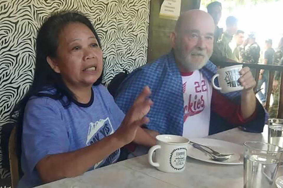In this image provided by Armed Forces of the Philippines, Task Force Sulu, British national Allan Hyrons and his Filipino wife Wilma gesture inside a military camp at Jolo, Sulu province, southern Philippines on Monday Nov. 25, 2019. A Philippine general says troops have rescued the British man and his Filipino wife who were abducted by gunmen in their beach resort in the south last month and taken to the jungle hideouts of local militants allied with the Islamic State group. (Armed Forces of the Philippines, Joint Task Force Sulu via AP)