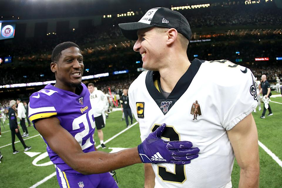 NEW ORLEANS, LOUISIANA - JANUARY 05: Xavier Rhodes #29 of the Minnesota Vikings reacts with Drew Brees #9 of the New Orleans Saints after the NFC Wild Card Playoff game at Mercedes Benz Superdome on January 05, 2020 in New Orleans, Louisiana. (Photo by Sean Gardner/Getty Images)
