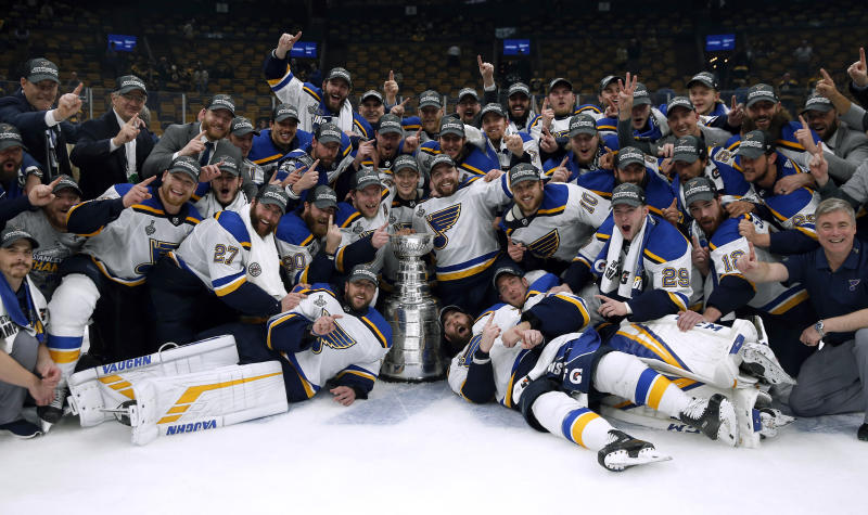The St. Louis Blues celebrate with the Stanley Cup after they defeated the Boston Bruins in Game 7 of the NHL Stanley Cup Final, Wednesday, June 12, 2019, in Boston. (AP Photo/Michael Dwyer)