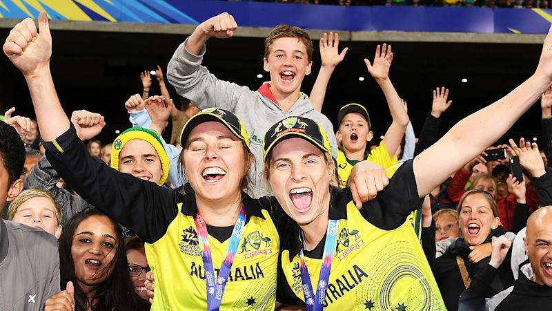 Molly Strano and Sophie Molineux are pictured celebrating their victory in the T20 World Cup.