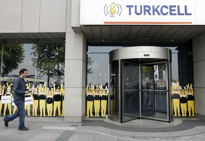 A man walks past the Turkcell head office in Istanbul