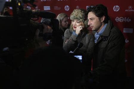 "Actors Kate Hudson and Zach Braff (R) attend the premiere of the film ""Wish I Was Here"" at the Sundance Film Festival in Park City, Utah, January 18, 2014. REUTERS/Jim Urquhart"