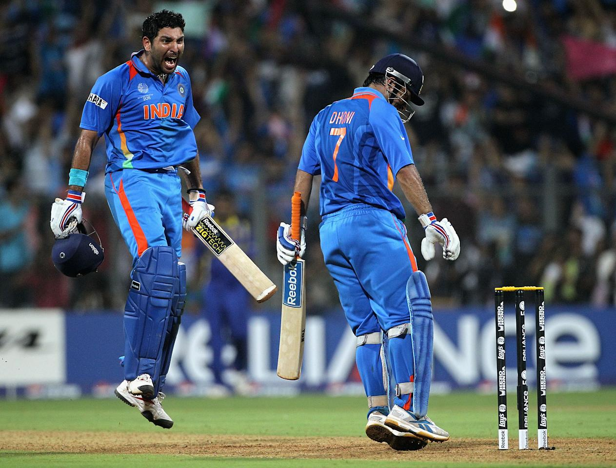 MUMBAI, INDIA - APRIL 02:  MS Dhoni and Yuvraj Singh of India celebrate after Dhoni hit a six to win the match during the 2011 ICC World Cup Final between India and Sri Lanka at Wankhede Stadium on April 2, 2011 in Mumbai, India.  (Photo by Hamish Blair/Getty Images)