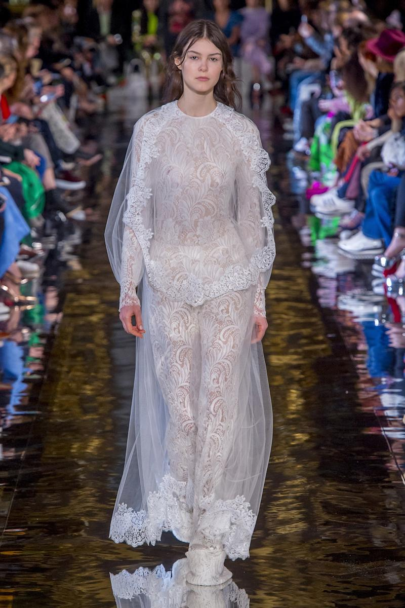 Image result for Stella McCartney The covered-up look took on an impossible lightness, and sex appeal, in transparent tulle and etched lace delicate enough to make the groom blush.