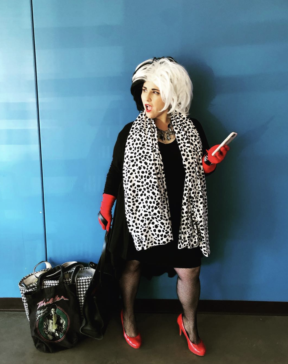 """<p>Besides the wig (and, ok, maybe the scarf), you <a href=""""https://www.oprahmag.com/entertainment/tv-movies/a28648872/disney-cruella-live-action-movie-premiere-date-trailer/"""" rel=""""nofollow noopener"""" target=""""_blank"""" data-ylk=""""slk:can nail this costume"""" class=""""link rapid-noclick-resp"""">can nail this costume</a> with just a handful of wardrobe staples: a black dress, a pair of red heels, and gloves. </p><p><a class=""""link rapid-noclick-resp"""" href=""""https://www.amazon.com/Mildiso-Cosplay-Costume-Resistant-Synthetic/dp/B07H3PJQQC?tag=syn-yahoo-20&ascsubtag=%5Bartid%7C10072.g.28615520%5Bsrc%7Cyahoo-us"""" rel=""""nofollow noopener"""" target=""""_blank"""" data-ylk=""""slk:SHOP WIG"""">SHOP WIG</a></p>"""