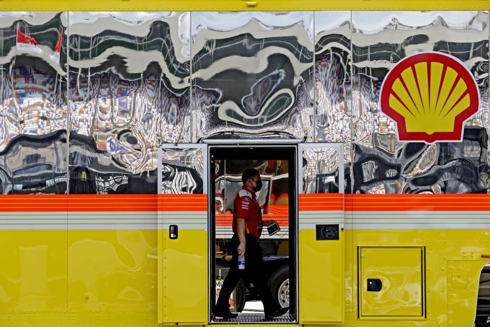 A crew member walks through the Team Penske truck prior to a NASCAR Cup Series auto race at Charlotte Motor Speedway Sunday, May 24, 2020, in Concord, N.C. (AP Photo/Gerry Broome)
