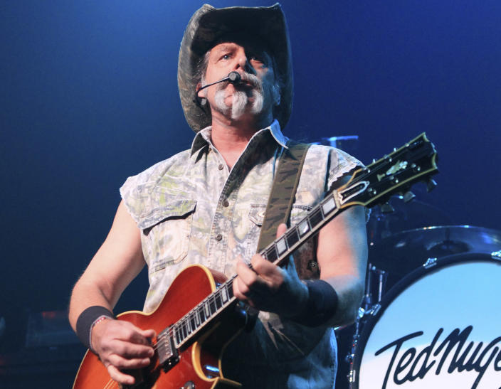 """FILE - Ted Nugent performs at Rams Head Live in Baltimore on Aug. 16, 2013. Nugent revealed he was in agony after testing positive for coronavirus — months after he said the virus was """"not a real pandemic."""" """"I thought I was dying,"""" Nugent says in a Facebook live video posted Monday. (Photo by Owen Sweeney/Invision/AP, File)"""