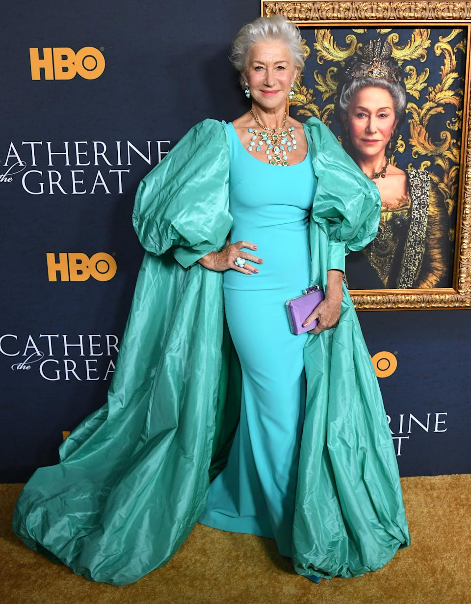 Helen wore a turquoise gown with dramatic sleeves by Badgley Mischka and accessorised with statement jewellery.<em> [Photo: Getty]</em>