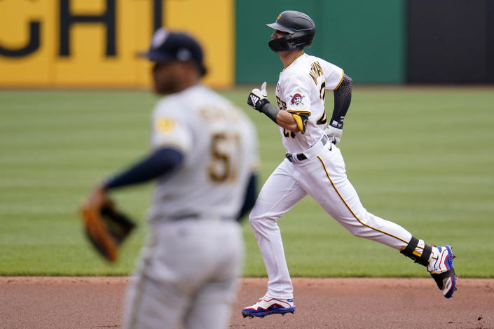 Pittsburgh Pirates' Kevin Newman, right, rounds second after hitting a solo home run off Milwaukee Brewers relief pitcher Freddy Peralta (51) during the first inning of a baseball game in Pittsburgh, Sunday, July 4, 2021. (AP Photo/Gene J. Puskar)