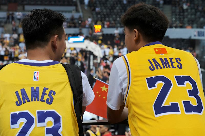 Basketball - NBA China Games - Los Angeles Lakers v Brooklyn Nets - Shenzhen, China - October 12, 2019. Fans are seen wearing LeBron James jerseys with an NBA logo covered by a Chinese national flag stickers during the game. REUTERS/Tyrone Siu