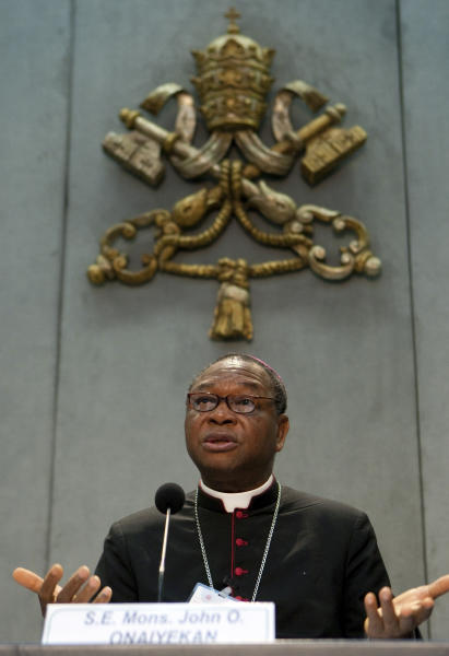 """FILE - This Oct. 23, 2009 file photo shows Archbishop of Abuja, Nigeria, John Olorunfemi Onaiyekan, presenting the message of the """"Second Special Assembly of the Synod of Bishops for Africa"""", at the Vatican's press room. Onaiyekan is one of the six new cardinals named by Pope Benedict XVI on Wednesday, Oct. 24, 2012 that will be elevated at a consistory Nov. 24 at the Vatican. (AP Photo/Andrew Medichini, file)"""