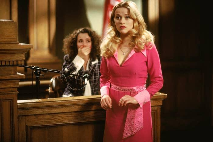 Elle Woods wears a pink dress in court as she cross examines a witness