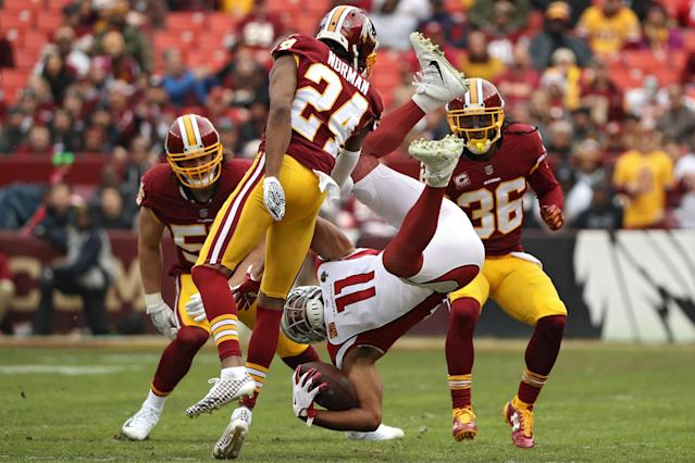 <p>Wide receiver Larry Fitzgerald #11 of the Arizona Cardinals is tackled by cornerback Josh Norman #24 of the Washington Redskins during the first quarter at FedExField on December 17, 2017 in Landover, Maryland. (Photo by Patrick Smith/Getty Images) </p>