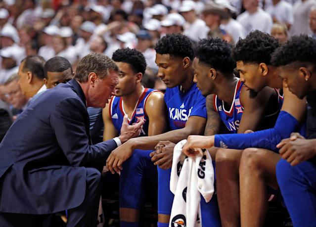 Kansas coach Bill Self talks to his players on the bench during the second half of the team's NCAA college basketball game against Texas Tech. (AP)
