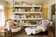 <p>Anchor your library by placing bookshelves in the center of the room. Finish the look with cozy seating, dressed with a mix of pillows and throw blankets. </p>