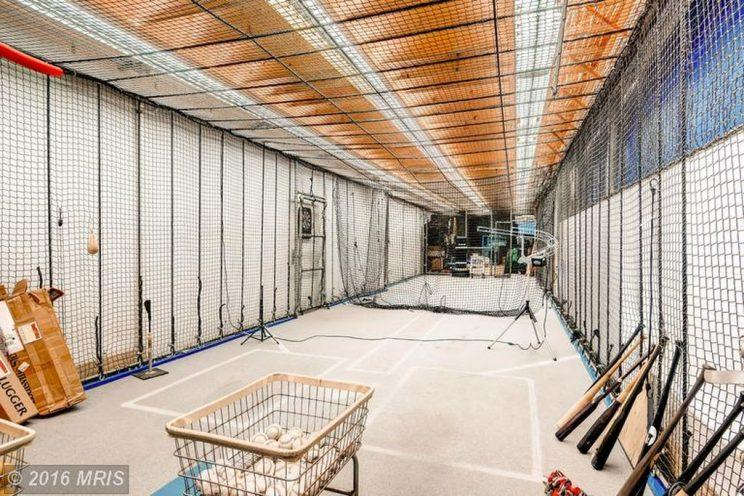 The batting cage in Ripken's house is pretty sweet. (Zillow)