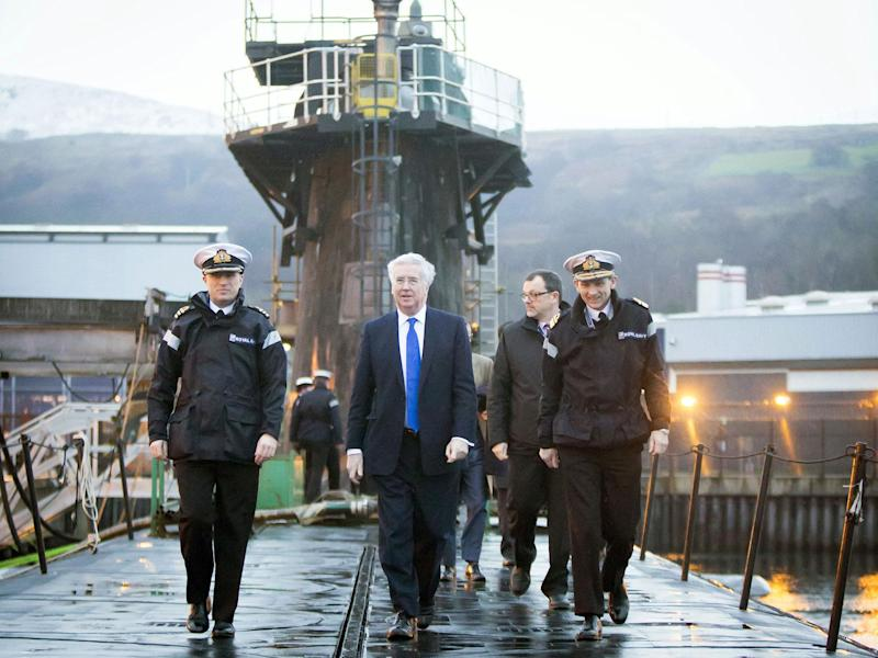 Sir Michael Fallon on board the HMS Vigilant in Clyde. The submarine is one of four vessels carrying the Trident nuclear system: Getty