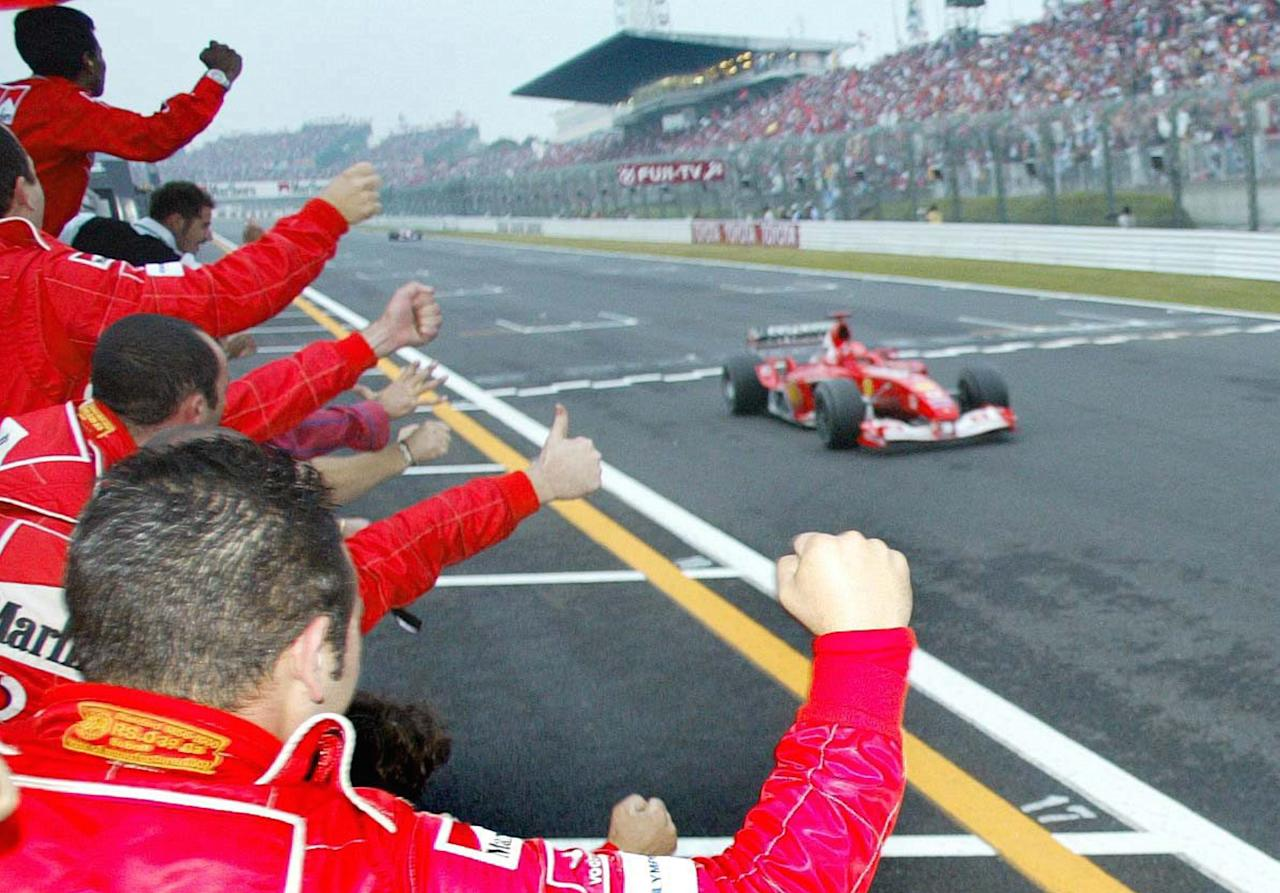 SUZUKA, JAPAN - OCTOBER 12:  GP von Japan 2003, Suzuka; Michael SCHUMACHER/Ferrari faehrt ueber die Ziellinie  (Photo by Alexander Hassenstein/Bongarts/Getty Images)