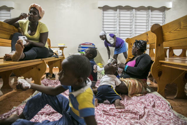 <p>Families gather at a shelter in a local church during the evening before the arrival of Hurricane Irma in Las Terrenas, Dominican Republic, Wednesday, Sept. 6, 2017. Dominicans wait for the arrival of Hurricane Irma after it lashed Puerto Rico with heavy rain and powerful winds, leaving nearly 900,000 people without power as authorities struggled to get aid to small Caribbean islands already devastated by the historic storm. ( Photo: Tatiana Fernandez/AP) </p>