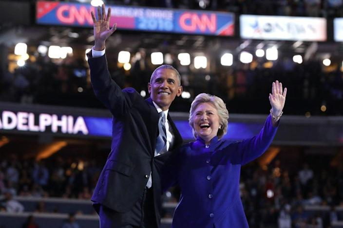 US President Barack Obama and Democratic Presidential nominee Hillary Clinton wave to the crowd on the third day of the Democratic National Convention at the Wells Fargo Center, July 27, 2016 in Philadelphia, Pennsylvania. (Photo by Chip Somodevilla/Getty Images)