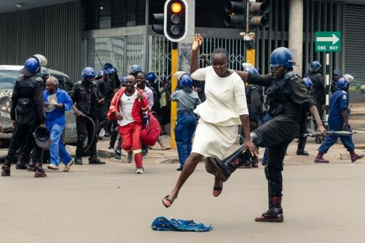 Zimbabwe anti-riot police fired tear gas and beat protesters in an opposition rally, AFP reporters said