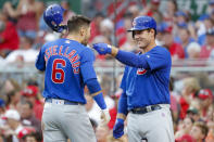 Chicago Cubs' Nicholas Castellanos (6) celebrates with Anthony Rizzo, right, after hitting a solo home run off Cincinnati Reds starting pitcher Alex Wood during the third inning of a baseball game Thursday, Aug. 8, 2019, in Cincinnati. (AP Photo/John Minchillo)