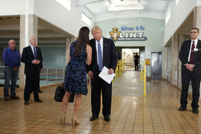 Republican presidential candidate Donald Trump, center, talks with his press secretary Hope Hicks during a tour of the Flint Water Plant and Facilities, Wednesday, Sept. 14, 2016, in Flint, Mich. (AP Photo/Evan Vucci)