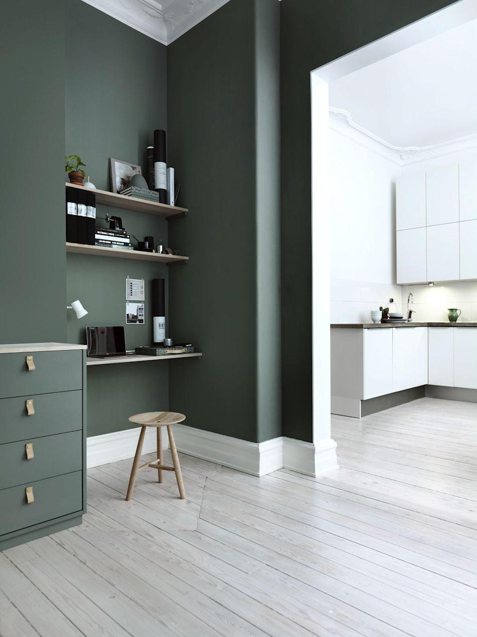 <p>This unobtrusive study is the ideal space for part-time homeworkers to catch up on paperwork. It's wonderfully simple to create, too – simply build bookshelves and make sure you have enough plug sockets nearby. Swedish eco furniture brand Norrgavel uses a change in wall colour to mark out a work zone in this open-plan home.</p>
