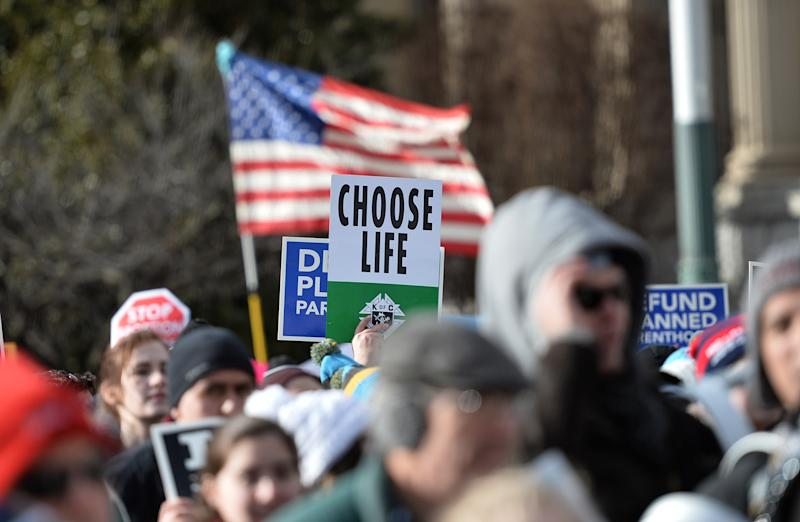 Anti-abortion protesters march in Washington, D.C., at the annual March for Life in January. Official government language establishing that life begins at conception could tilt the scales toward more infringement on women's reproductive choices. (ANDREW CABALLERO-REYNOLDS/AFP via Getty Images)