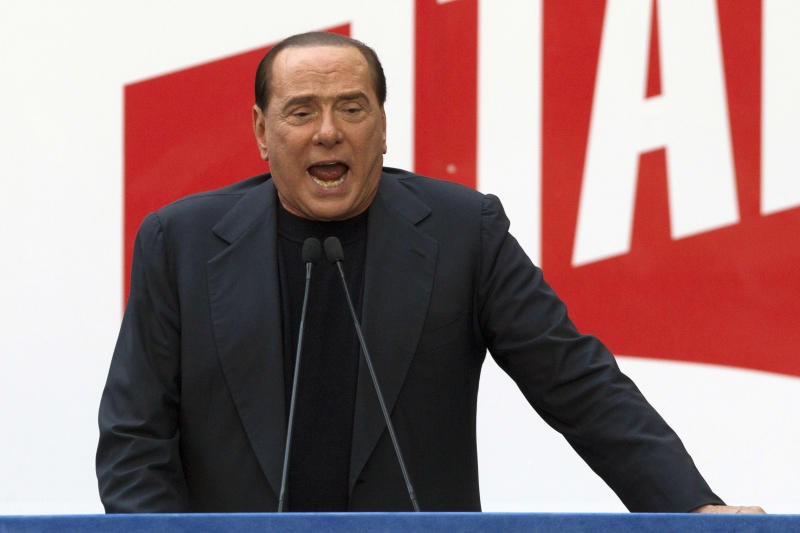 FILE - In this Sunday, Aug. 4, 2013 file photo, former Italian Premier Silvio Berlusconi addresses supporters during a demonstration in front of his residence in Rome. Government ministers in former Premier Silvio Berlusconi's political party have announced Saturday, Sept. 28, 2013 their intention to resign their posts, a move that raises tension in the uneasy coalition government and increases the possibility of early elections. Vice Premier Angelino Alfano's spokeswoman said Saturday the five ministers from Berlusconi's center-right People of Freedom Party have decided to submit their resignations. (AP Photo/Andrew Medichini, Files)