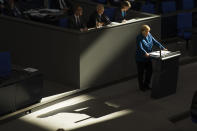 FILE - In this Wednesday, Oct. 17, 2018 file photo, German Chancellor Angela Merkel casts a shadow as she delivers a speech on the Europe-Britain 'Brexit' negotiations and the upcoming meeting of European leaders in Brussels during a meeting of the German federal parliament, Bundestag, at the Reichstag building in Berlin, Germany. German voters elect a new parliament on Sunday, Sept. 26, 2021, a vote that will determine who succeeds Chancellor Angela Merkel after her 16 years in power. (AP Photo/Markus Schreiber, File)