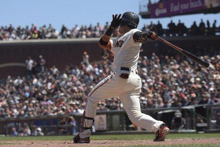 Jun 20, 2018; San Francisco, CA, USA; San Francisco Giants left fielder Gorkys Hernandez (7) hits an rbi single during the sixth inning of the game against the Miami Marlins at AT&T Park. Mandatory Credit: Ed Szczepanski-USA TODAY Sports