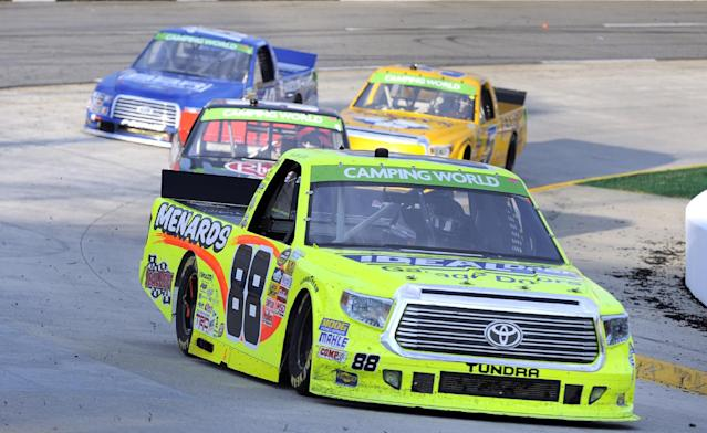 Driver Matt Crafton driver through turn four during a NASCAR Truck Series auto race at Martinsville Speedway in Martinsville, Va., Sunday, March 30, 2014. (AP Photo/Mike McCarn)
