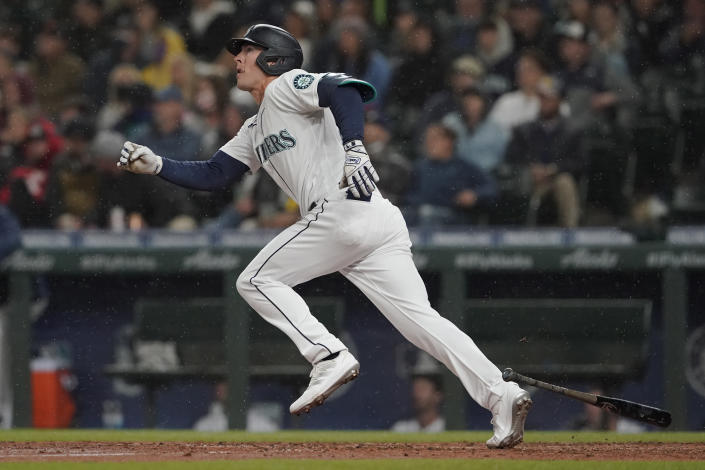 Seattle Mariners' Dylan Moore watches his two-run home run as rain falls in the sixth inning of a baseball game against the Houston Astros, Monday, Aug. 30, 2021, in Seattle. (AP Photo/Ted S. Warren)