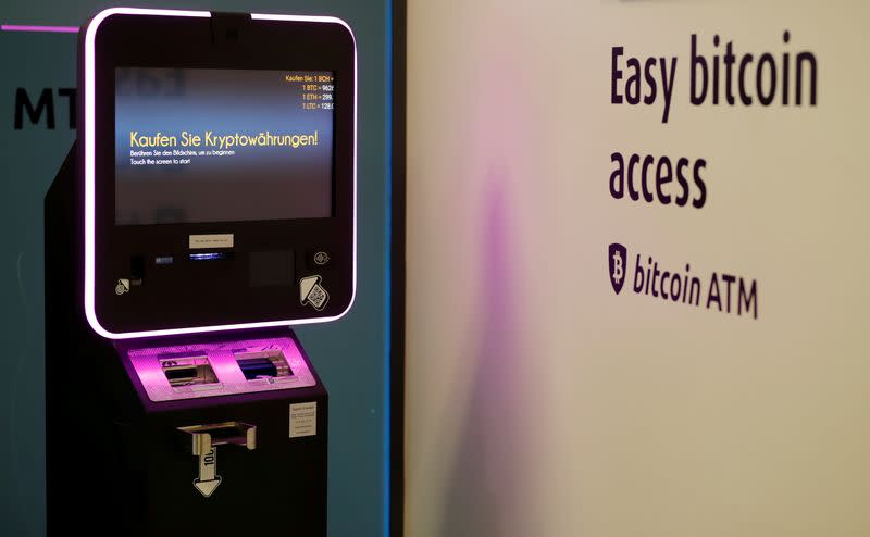 """FILE PHOTO: """"Buy cryptocurrencies"""" is seen on the display of a cryptocurrency ATM at the headquarters of Swiss Falcon Private Bank in Zurich"""