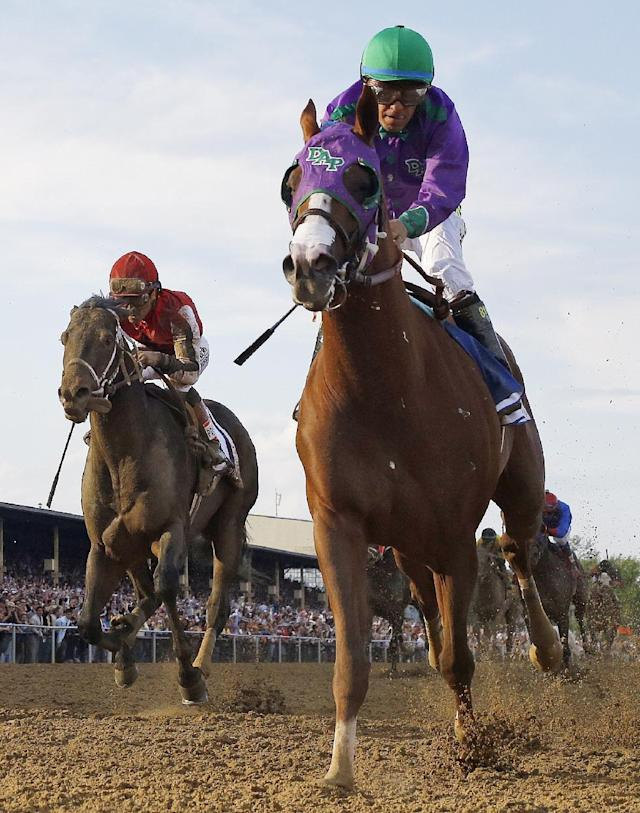 California Chrome, front, ridden by jockey Victor Espinoza, wins the 139th Preakness Stakes horse race at Pimlico Race Course, Saturday, May 17, 2014, in Baltimore.(AP Photo/Matt Slocum)