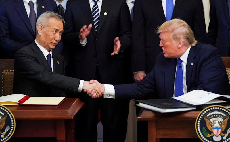 "Chinese Vice Premier Liu He and U.S. President Donald Trump shake hands after signing ""phase one"" of the U.S.-China trade agreement during a ceremony in the East Room of the White House in Washington, U.S., January 15, 2020. REUTERS/Kevin Lamarque"