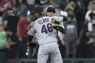 Cleveland Indians closing pitcher Emmanuel Clase (48) celebrates with first baseman Yu Chang after the Indians defeated the Chicago White Sox 12-11 in a baseball game Saturday, July 31, 2021, in Chicago. (AP Photo/Paul Beaty)
