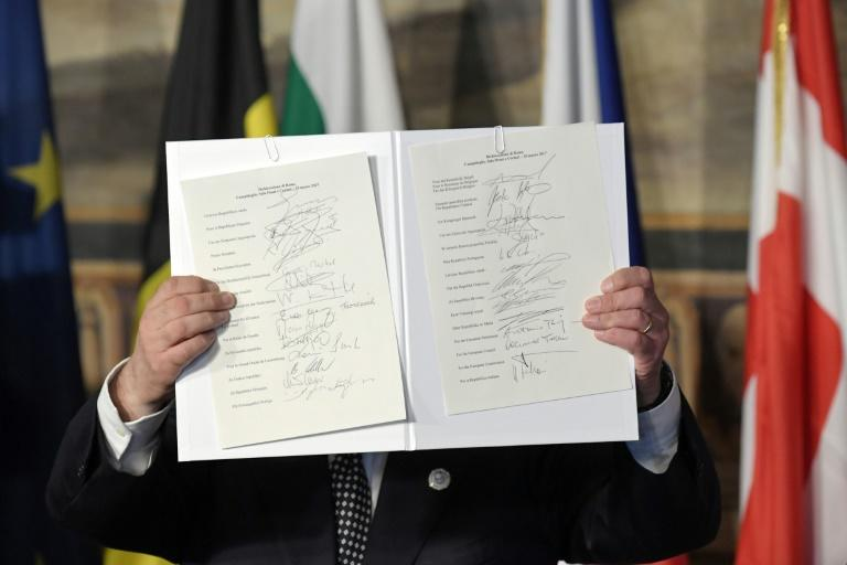 EU Parliament president Antonio Tajani holds up the new Rome declaration signed by leaders of 27 European Union countries during a summit of EU leaders to mark the 60th anniversary of the bloc's founding Treaty of Rome, in Rome on March 25, 2017