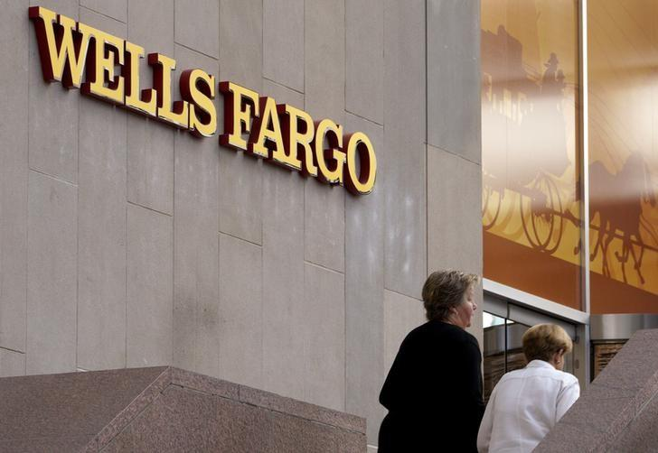 FILE PHOTO: Customers approach the Wells Fargo & Co. bank in downtown Denver