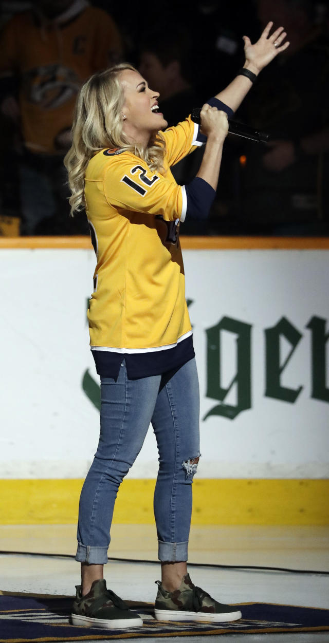 Carrie Underwood sings the national anthem before Game 2 of an NHL hockey second-round playoff series between the Nashville Predators and the Winnipeg Jets, Sunday, April 29, 2018, in Nashville, Tenn. Underwood is wearing the jersey number of her husband, Predators center Mike Fisher. (AP Photo/Mark Humphrey)