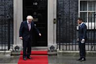Britain's Prime Minister Boris Johnson (L) greets President of Ukraine Volodymyr Zelensky outside number 10 Downing Street in central London on October 8, 2020, prior to their meeting. (Photo by Daniel LEAL-OLIVAS / AFP) (Photo by DANIEL LEAL-OLIVAS/AFP via Getty Images)