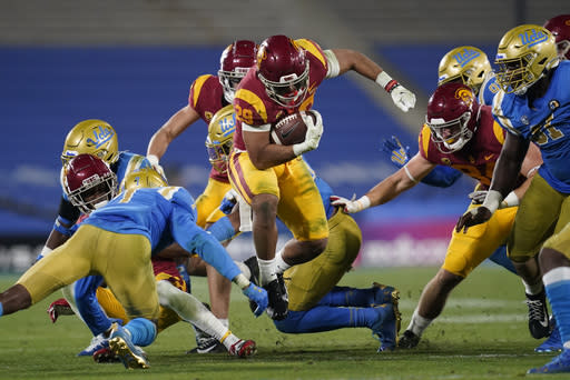 Southern California running back Vavae Malepeai, center, runs the ball during the fourth quarter of an NCAA college football game against UCLA, Saturday, Dec 12, 2020, in Pasadena, Calif. (AP Photo/Ashley Landis)