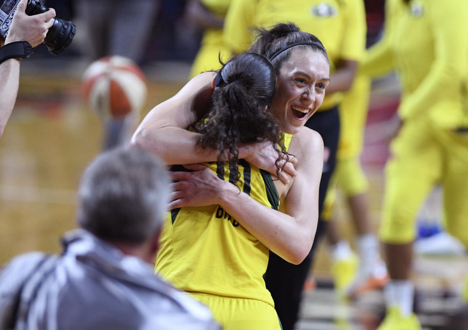 Seattle Storm forward Breanna Stewart, back, celebrates and hugs guard Sue Bird (10) after Game 3 of the WNBA basketball finals against the Washington Mystics, Wednesday, Sept. 12, 2018, in Fairfax, Va. The Storm won 98-82. (AP Photo/Nick Wass)