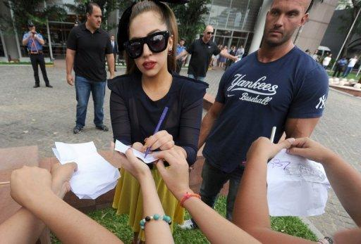 Lady Gaga signs autographs for fans in Paraguay, on November 26, 2012
