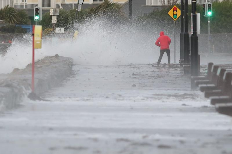 A man avoids the waves at Salthill promenade, Co Galway during Storm Callum: PA