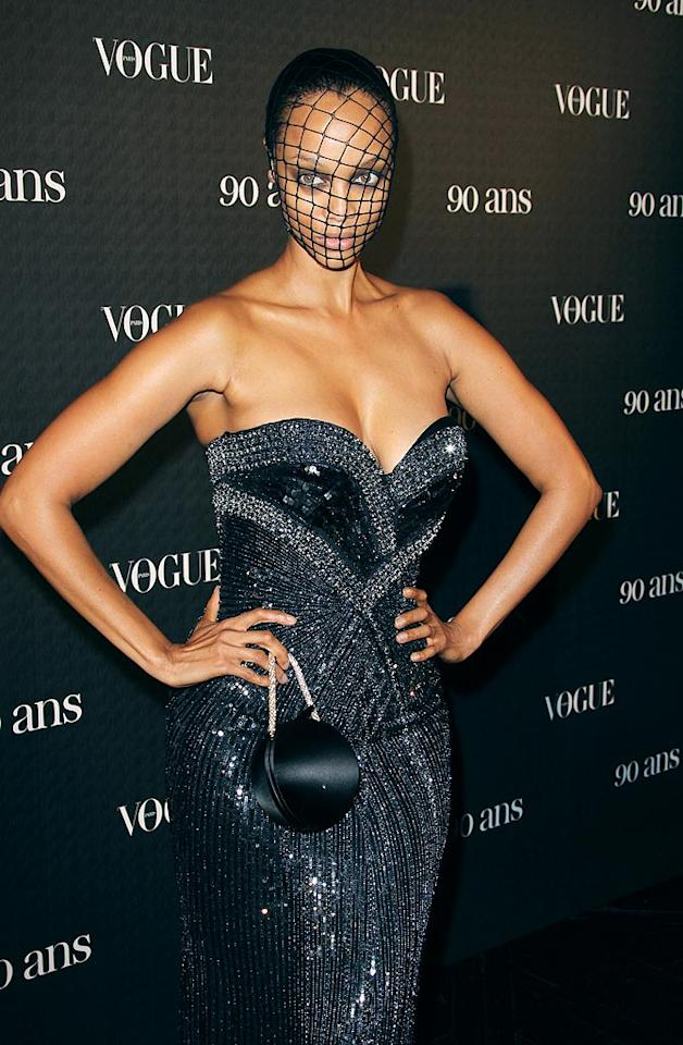 """Tyra Banks got tangled in this frightening fashion faux pas upon arriving at <i>Vogue</i>'s 90th anniversary party in Paris. Later that evening, she took to her Twitter account to dispel rumors that the accessory was a hairnet or a pair of undies. According to the """"Top Model"""" hostess, the macabre mask was, """" ... sum cheap FISHNET stockings I got n crazy store n Paris! I cut em up and made it y'all."""" Needless to say, fashion design isn't her forte. Tony Barson/<a href=""""http://www.filmmagic.com/"""" target=""""new"""">FilmMagic.com</a> - September 30, 2010"""