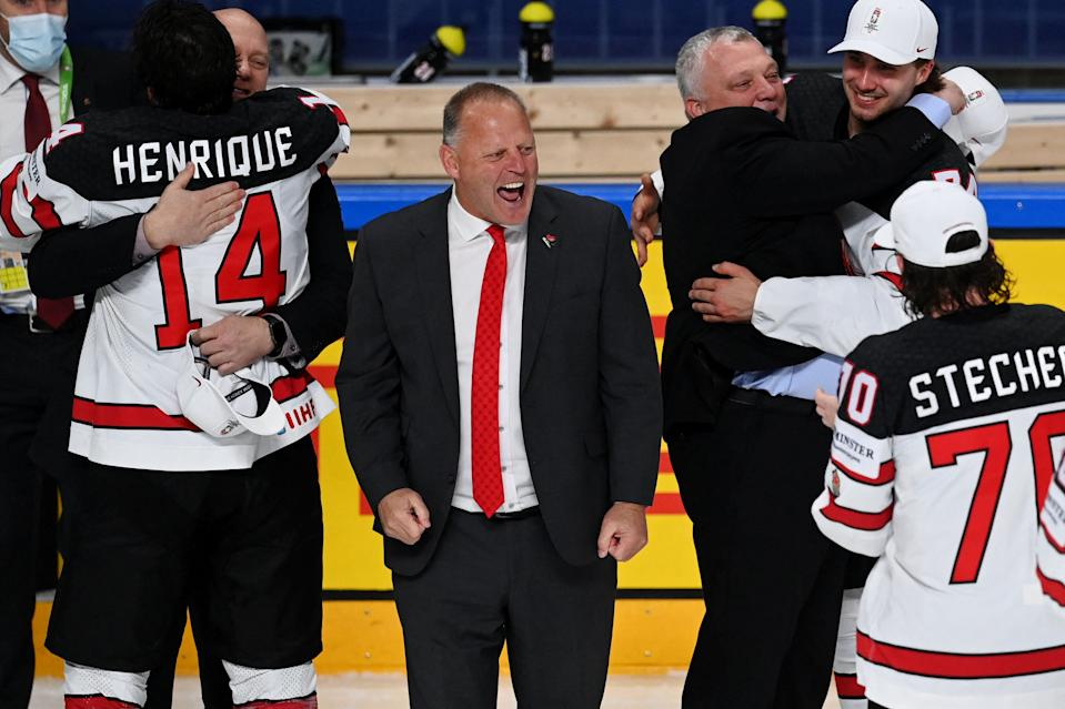 Canada's head coach Gerard Gallant (C) celebrates after his team won the IIHF Men's Ice Hockey World Championships final match between the Finland and Canada at the Arena Riga in Riga, Latvia, on June 5, 2021. - A 3-2 victory over Finland crowned Canada Ice Hockey World Champions 2021. (Photo by Gints IVUSKANS / AFP) (Photo by GINTS IVUSKANS/AFP via Getty Images)