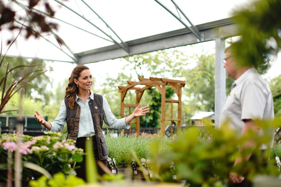 Britain's Catherine, Duchess of Cambridge, talks to Martin and Jennie Turner, owners of the Fakenham Garden Centre in Norfolk on June 18, 2020. - The Duchess visited the family-run independent business, which first opened in 1984, to hear about how the Covid-19 pandemic had impacted the company. (Photo by Aaron Chown / POOL / AFP) (Photo by AARON CHOWN/POOL/AFP via Getty Images)
